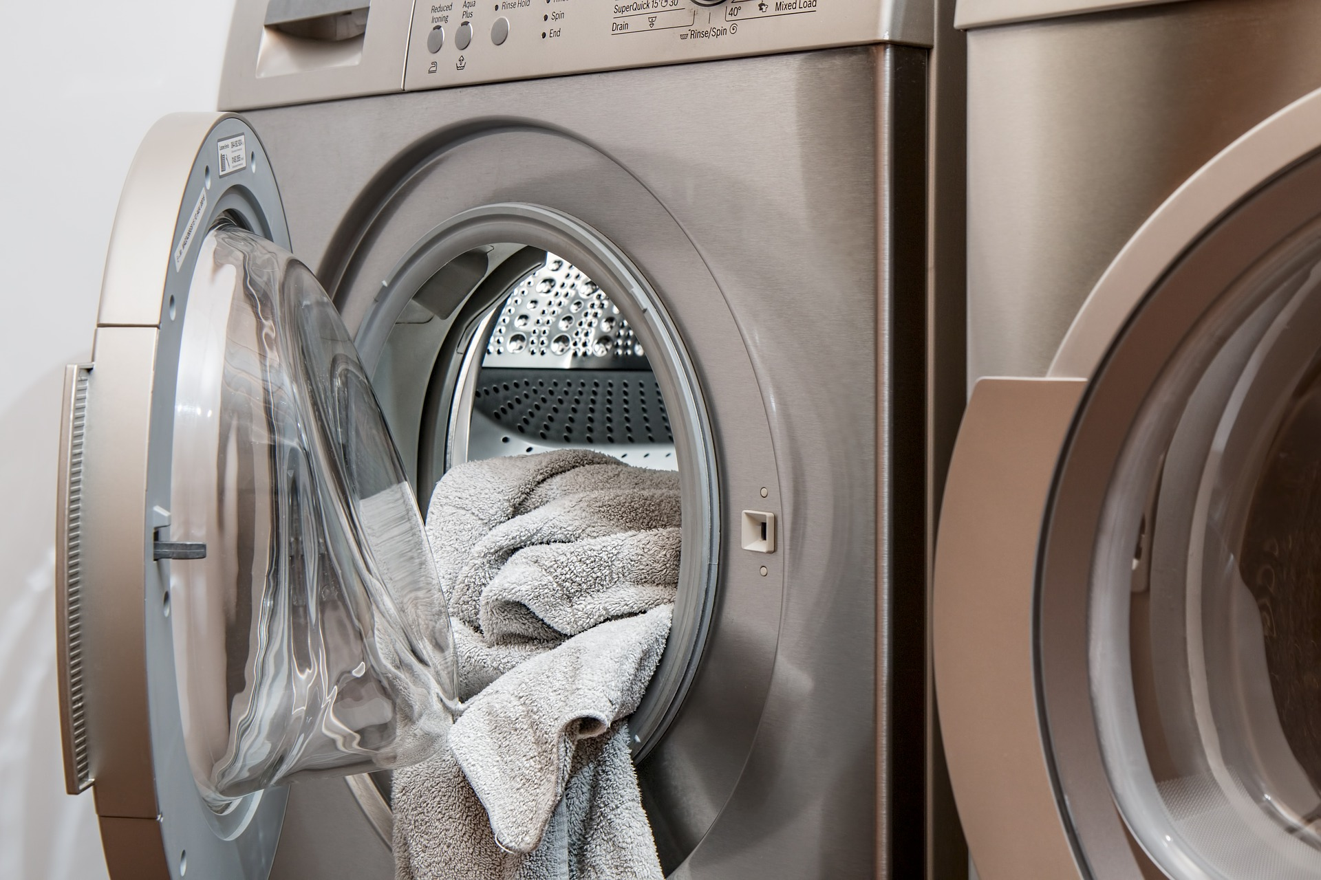 Clothing dryer open with towel inside