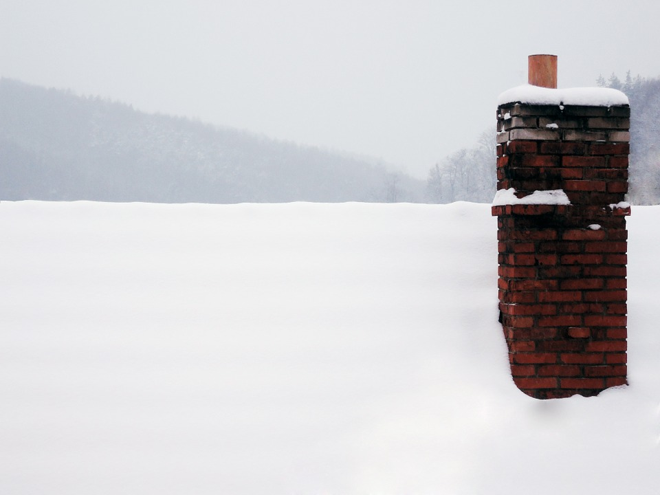 Roof and chimney covered in snow
